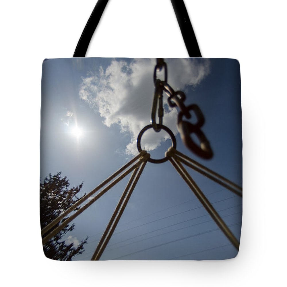 Background Tote Bag featuring the photograph Swinging In A Hammock by Michael Goyberg