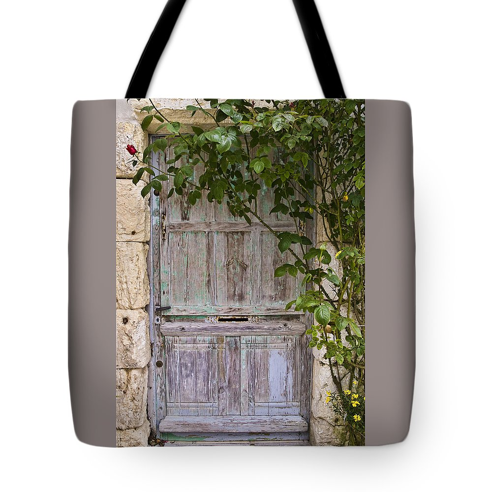 Talmont Door Tote Bag featuring the photograph Talmont Door by Wes and Dotty Weber