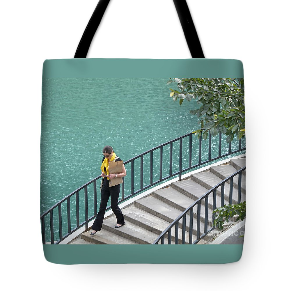 Texting Tote Bag featuring the photograph Texting As She Goes by Ann Horn