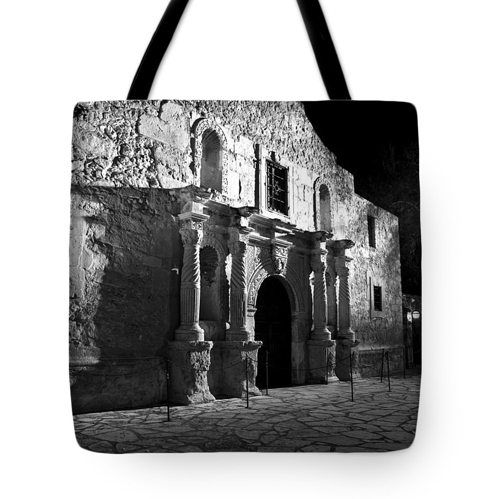 Revolutionary Tote Bag featuring the photograph The Alamo At Night by Jim Chamberlain