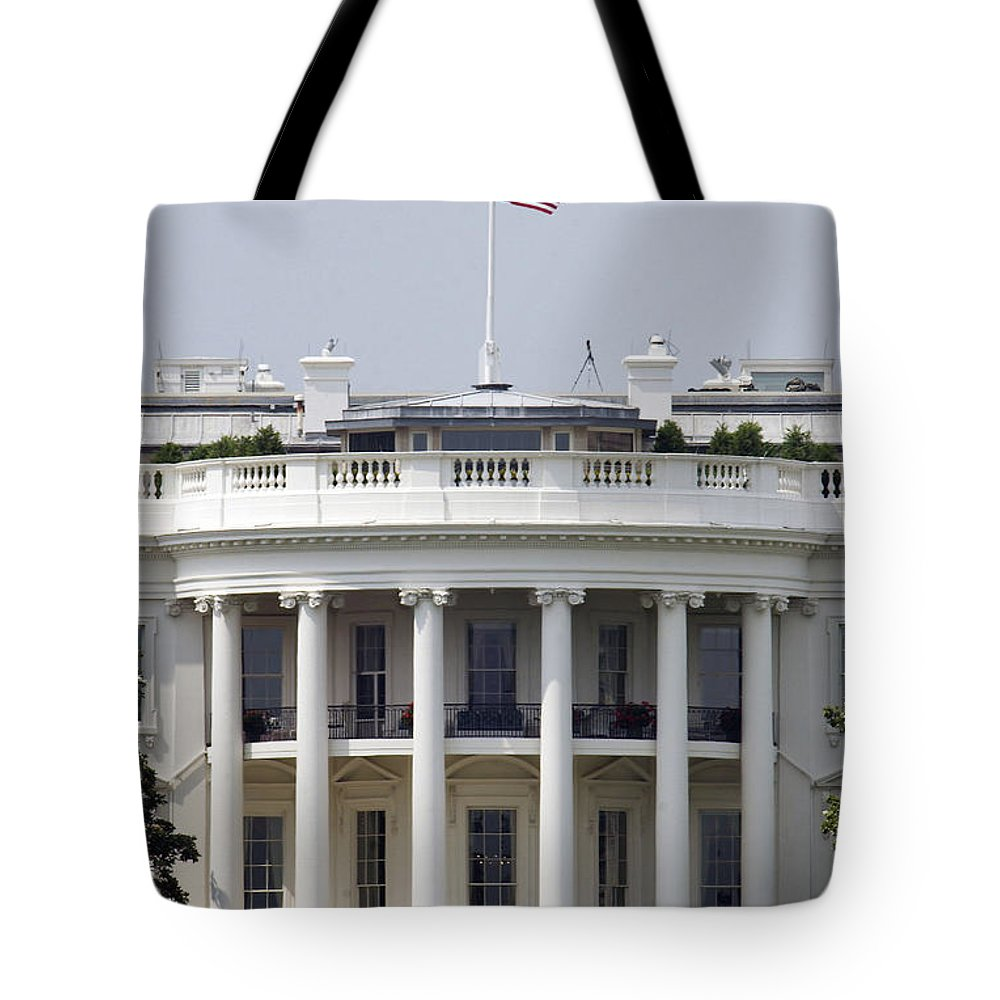 Washington Dc Tote Bag featuring the photograph The American Flag Flies At Half-staff by Stocktrek Images