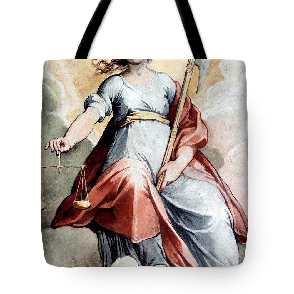 Justice Tote Bag featuring the photograph The Angel Of Justice by Munir Alawi