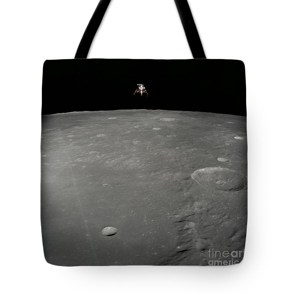 Intrepid Tote Bag featuring the photograph The Apollo 12 Lunar Module Intrepid by Stocktrek Images