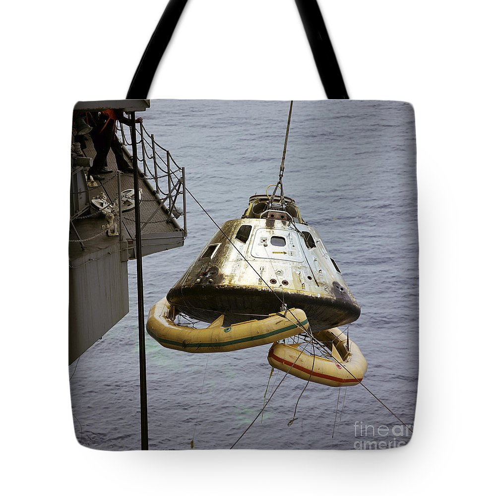 1969 Tote Bag featuring the photograph The Apollo 9 Command Module Is Hoisted by Stocktrek Images