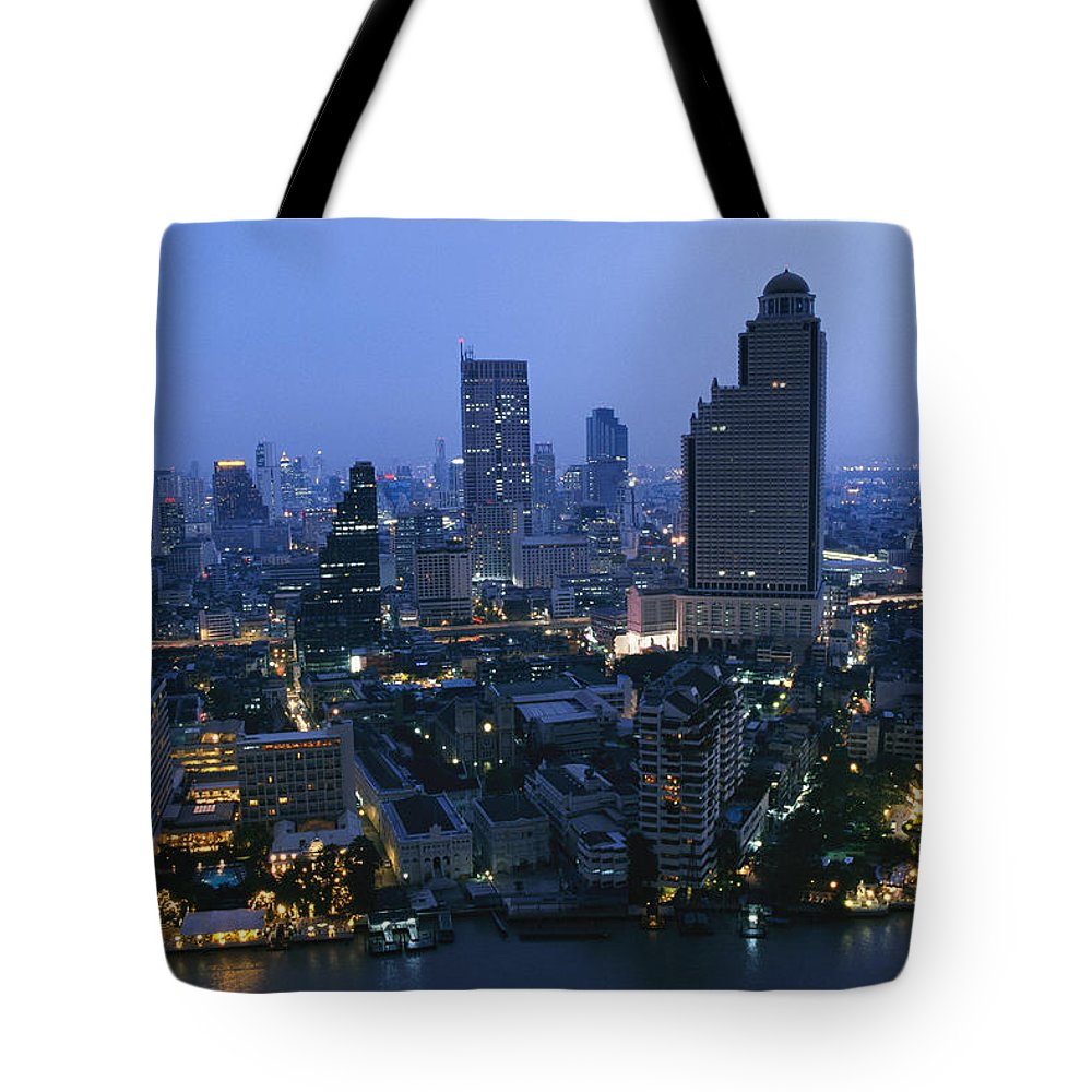 Asia Tote Bag featuring the photograph The Bangkok Skyline At Dusk by Richard Nowitz