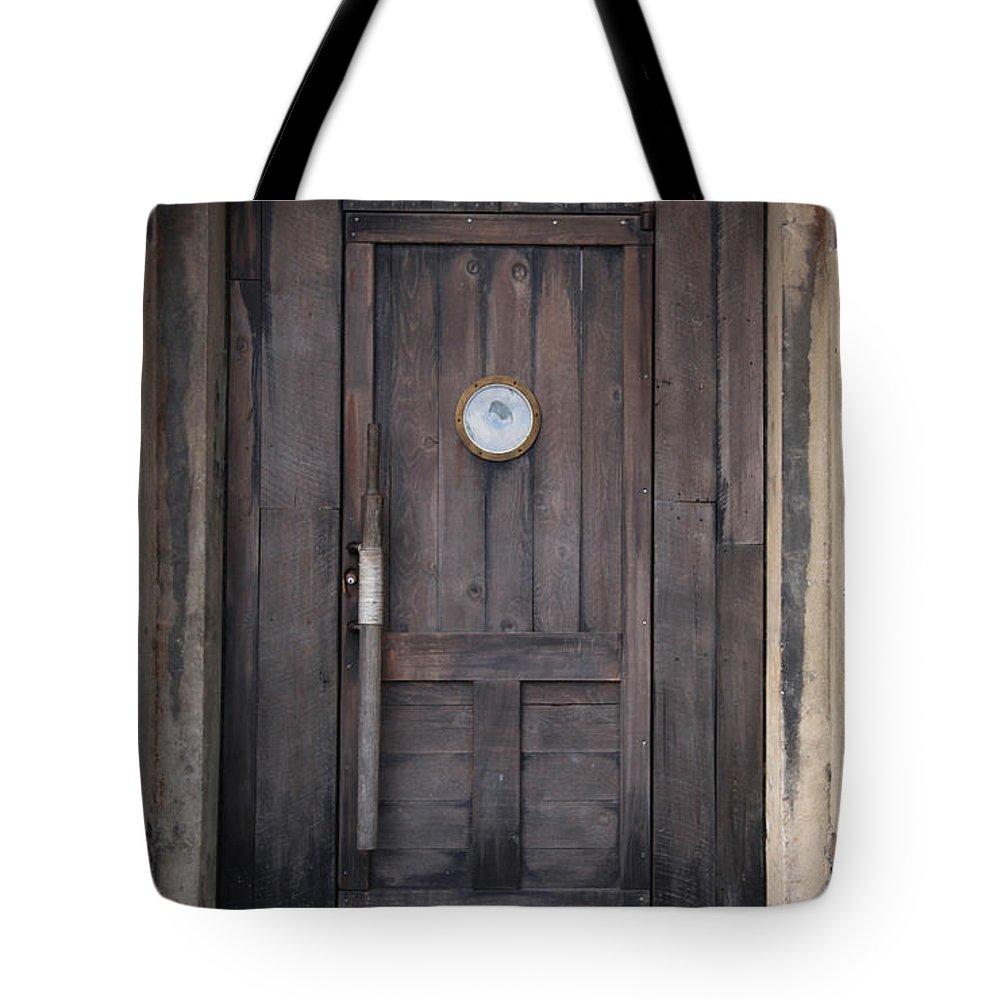 Savannah Ga Tote Bag featuring the photograph The Bar Door by Carol Ann Thomas