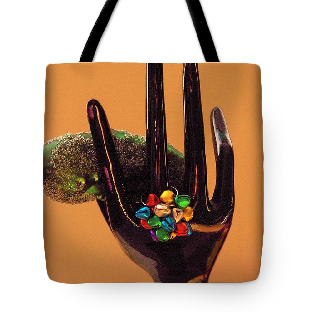Hand Tote Bag featuring the photograph The Christmas Pickle by Rob Hans