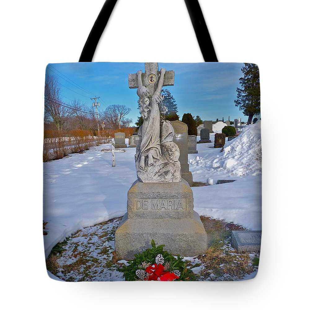 Cemetery Photographs Tote Bag featuring the photograph The Clinging Cross by Catherine Conroy
