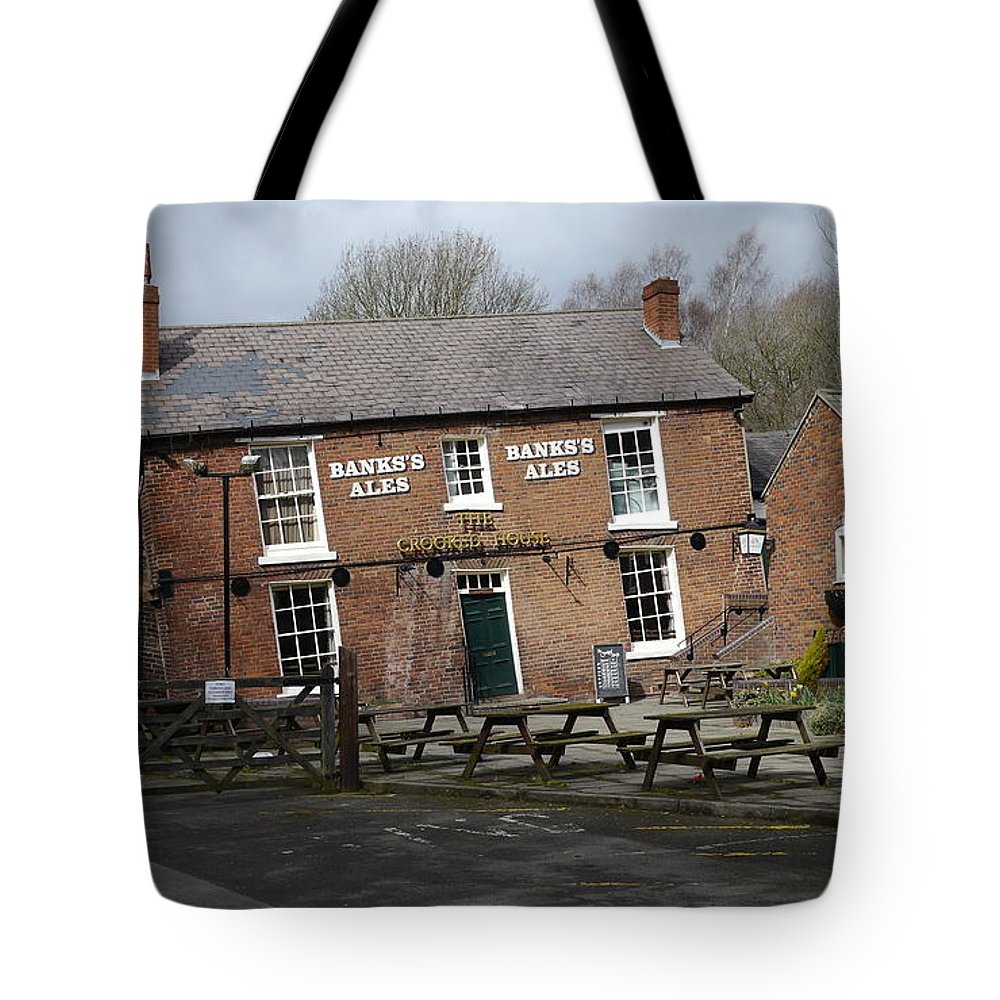 Crooked Tote Bag featuring the photograph The Crooked House by John Chatterley