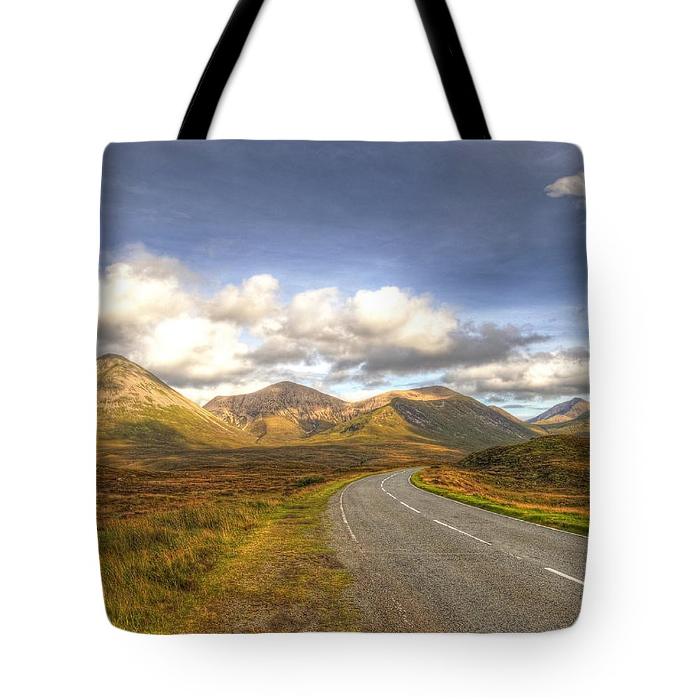 Cuillin Mountains Tote Bag featuring the photograph The Cuillin Mountains Of Skye by Chris Thaxter