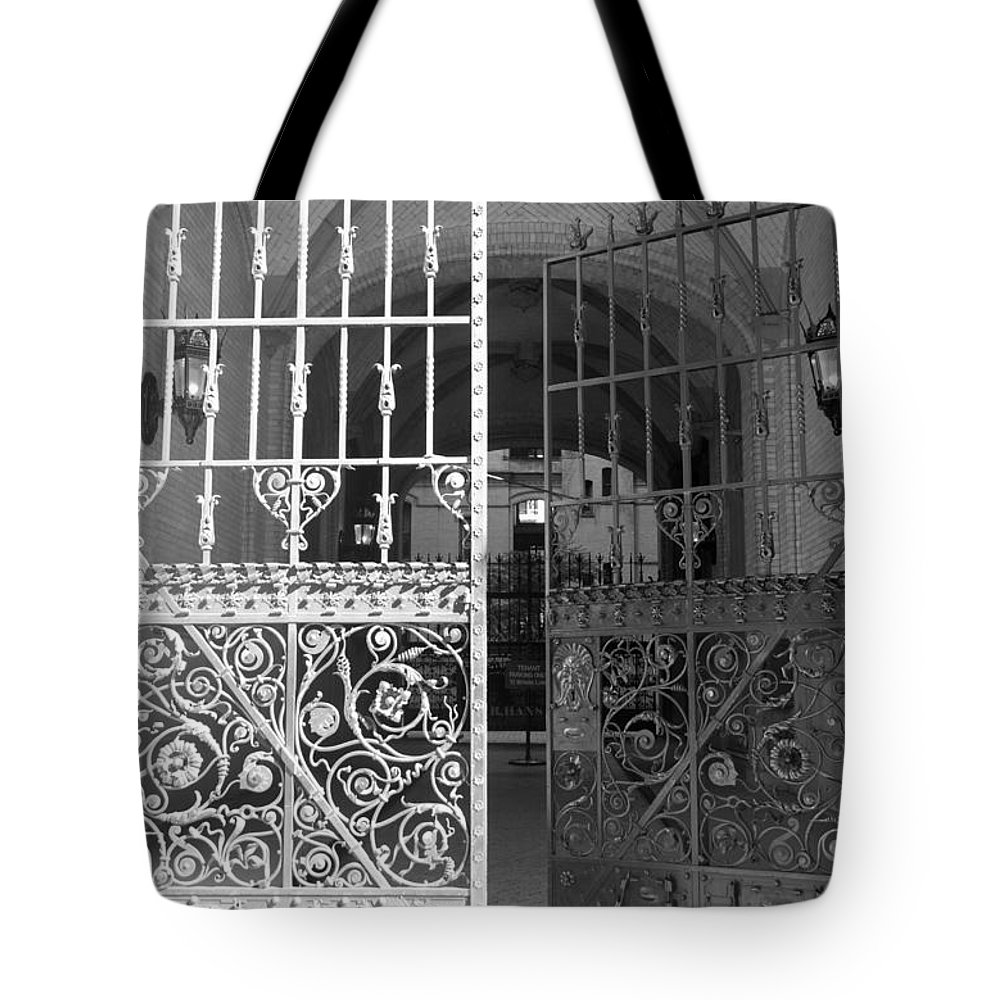 Black And White Tote Bag featuring the photograph The Dakota Gates In Black And White by Rob Hans