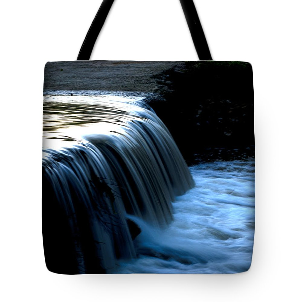 Flash Flood Tote Bag featuring the photograph The Flash Flood by Focus Fotos