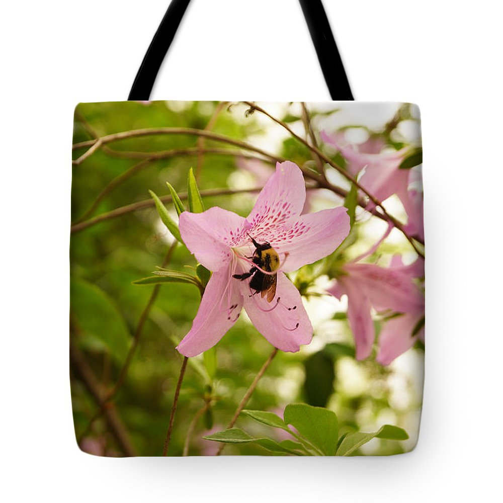 Bee Tote Bag featuring the photograph The Flower And The Bumble Bee by J Jaiam