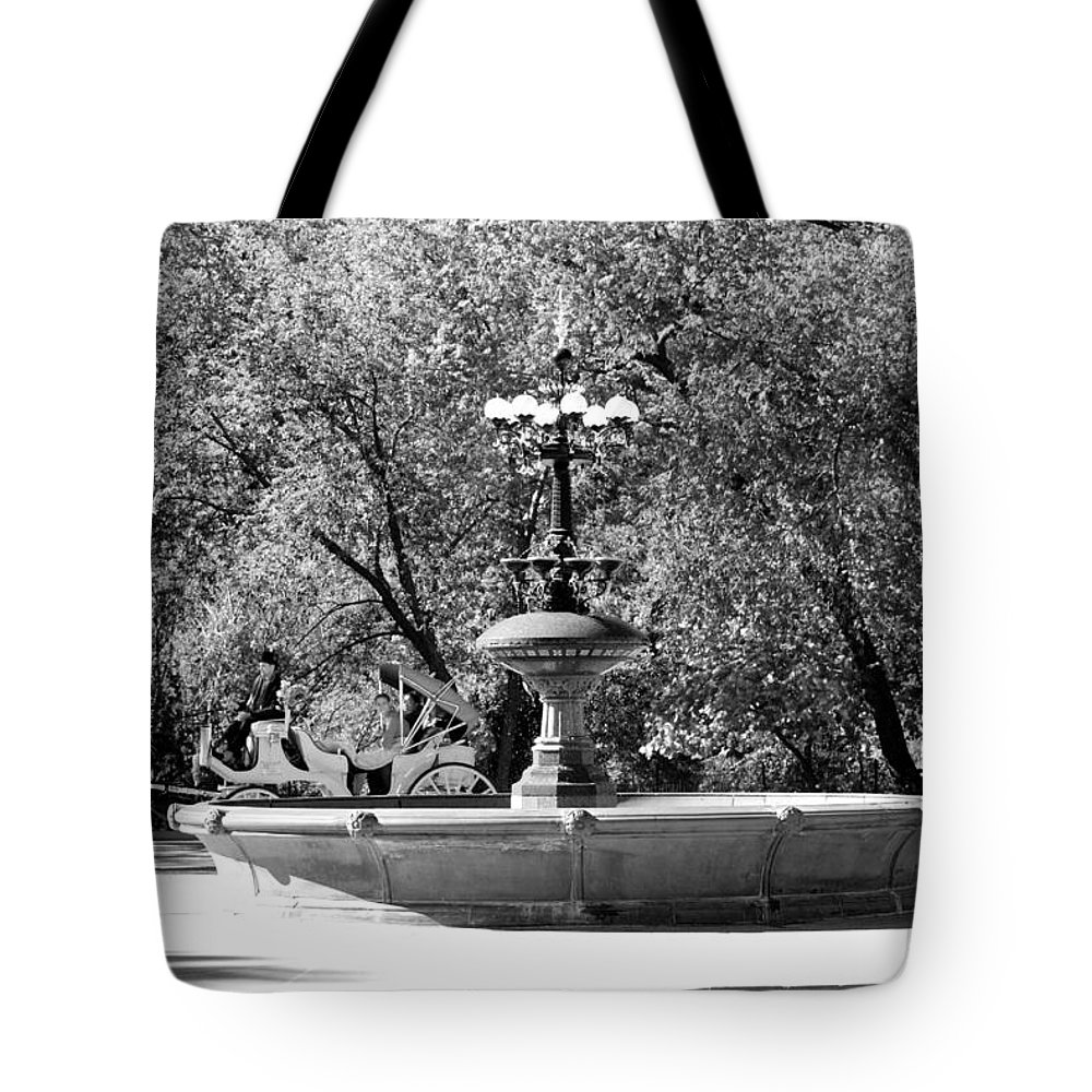 Central Park Tote Bag featuring the photograph The Fountain And The Ride In Black And White by Rob Hans