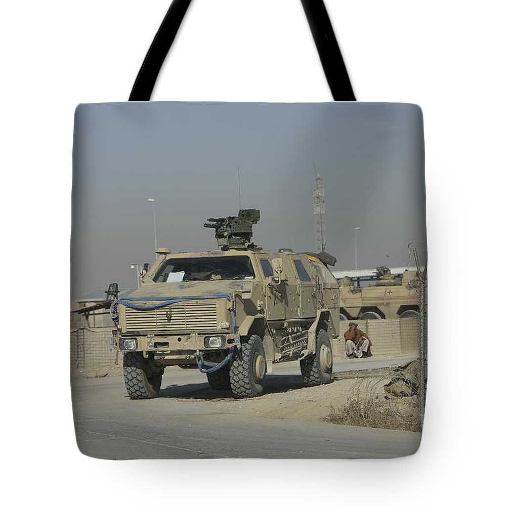 Mrap Tote Bag featuring the photograph The German Army Atf Dingo With A Turret by Terry Moore