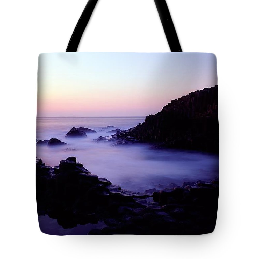 Back Lit Tote Bag featuring the photograph The Giants Causeway, Co Antrim, Ireland by The Irish Image Collection