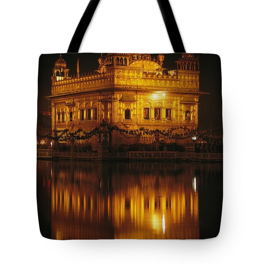 Asia Tote Bag featuring the photograph The Golden Temple Is Reflected by James P. Blair
