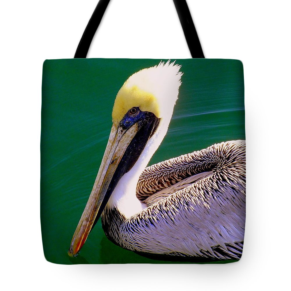 Pelicans Tote Bag featuring the photograph The Happy Pelican by Karen Wiles