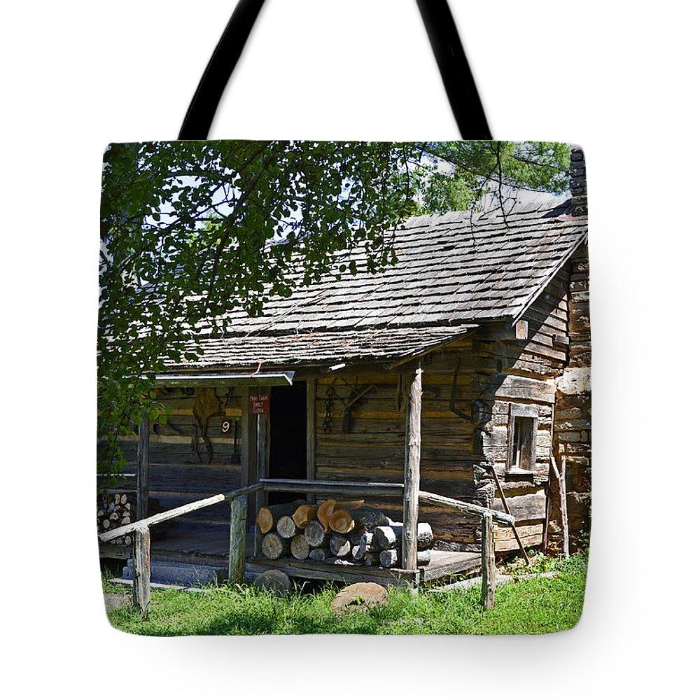 Mark Twain Tote Bag featuring the photograph The Mark Twain Family Cabin by Paul Mashburn