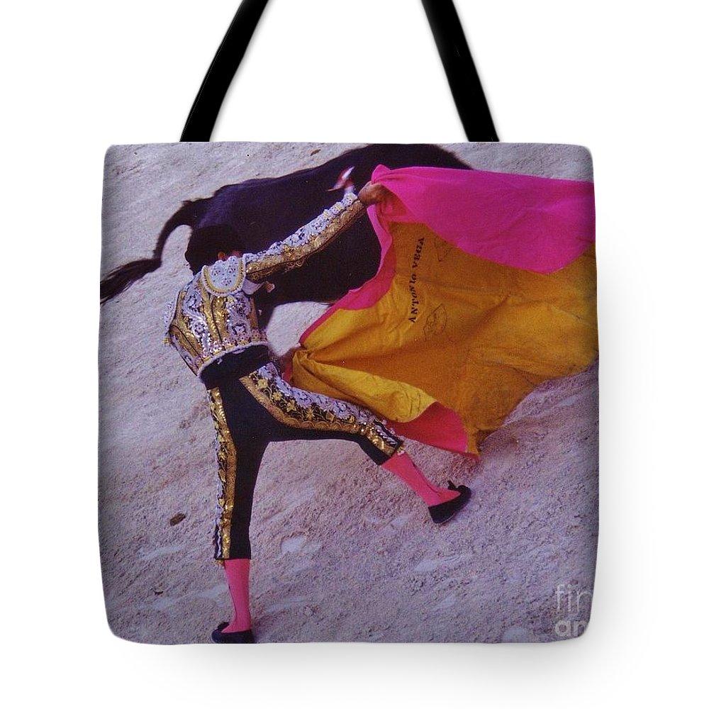 Matadore Tote Bag featuring the photograph The Matadore by John Malone