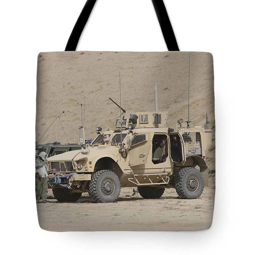 Armored Vehicles Tote Bag featuring the photograph The Oshkosh M-atv Mrap by Terry Moore