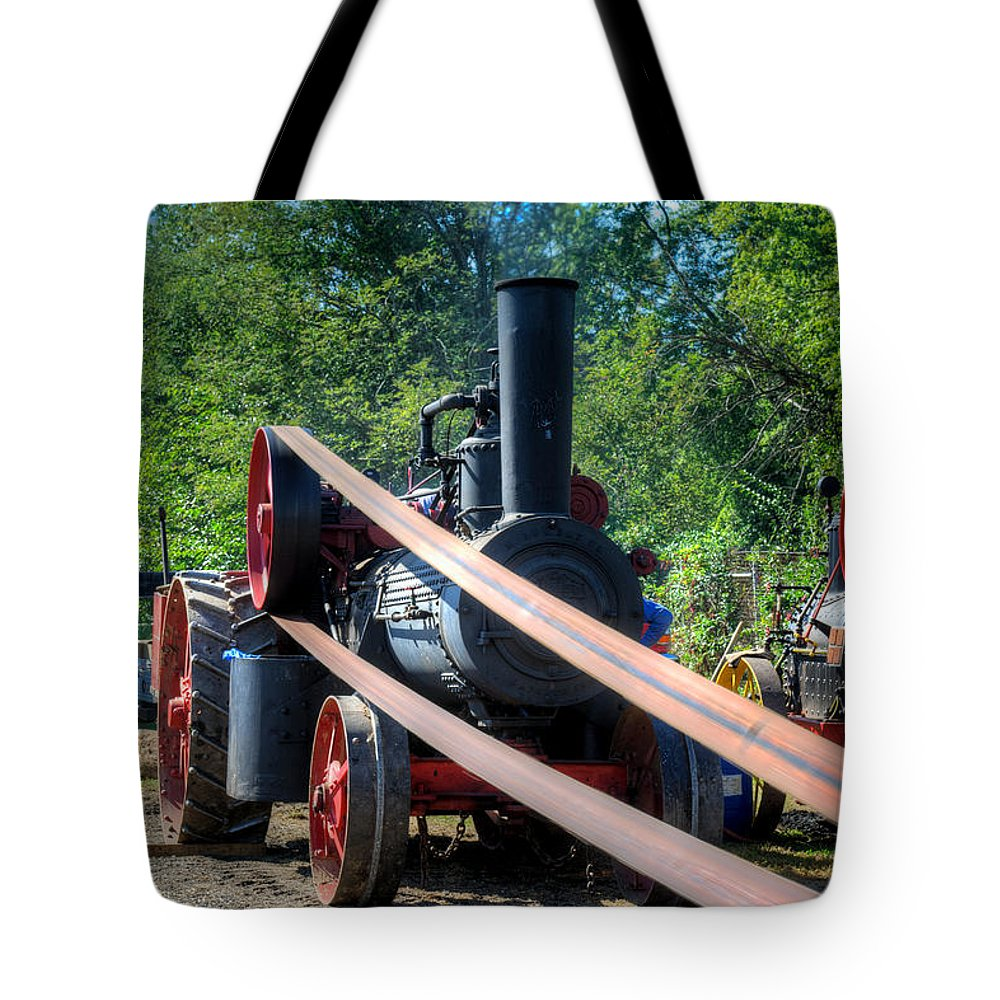 Arcadia Volunteer Fire Company Tote Bag featuring the photograph The Rumley Powering The Saw by Mark Dodd