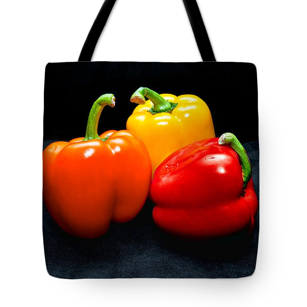 Vegetable Tote Bag featuring the photograph The Three Peppers by Christopher Holmes