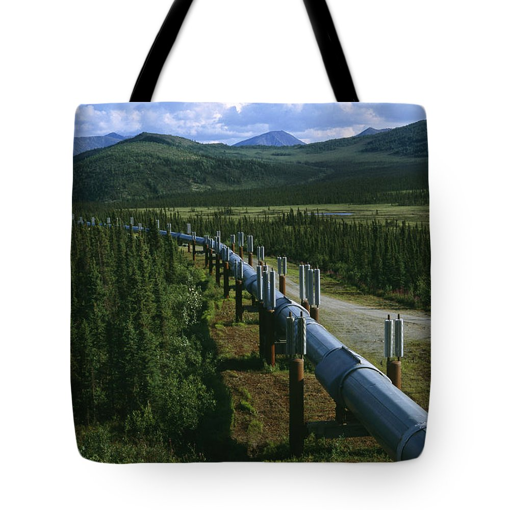 North America Tote Bag featuring the photograph The Trans-alaska Pipeline Runs by Melissa Farlow