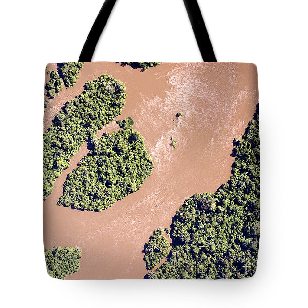 Landscape Tote Bag featuring the photograph The Turbid Ituri River Channels Its Way by Michael Fay