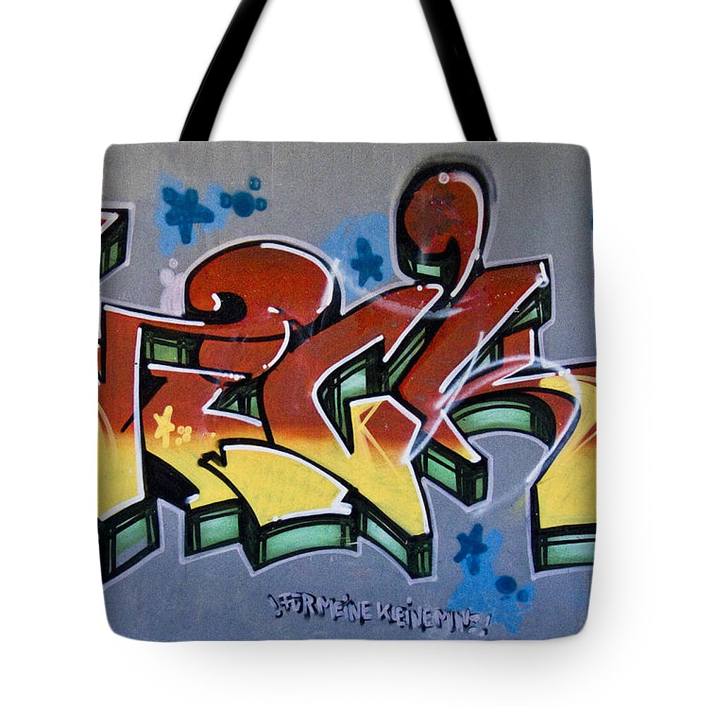 Graffiti Tote Bag featuring the photograph The Writing On The Wall by Heiko Koehrer-Wagner