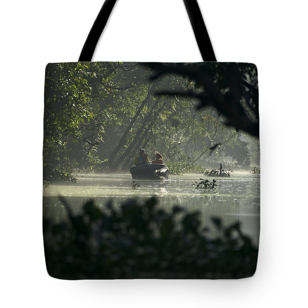 Borneo Tote Bag featuring the photograph Tourists Exploring The Rain Forest by Tim Laman