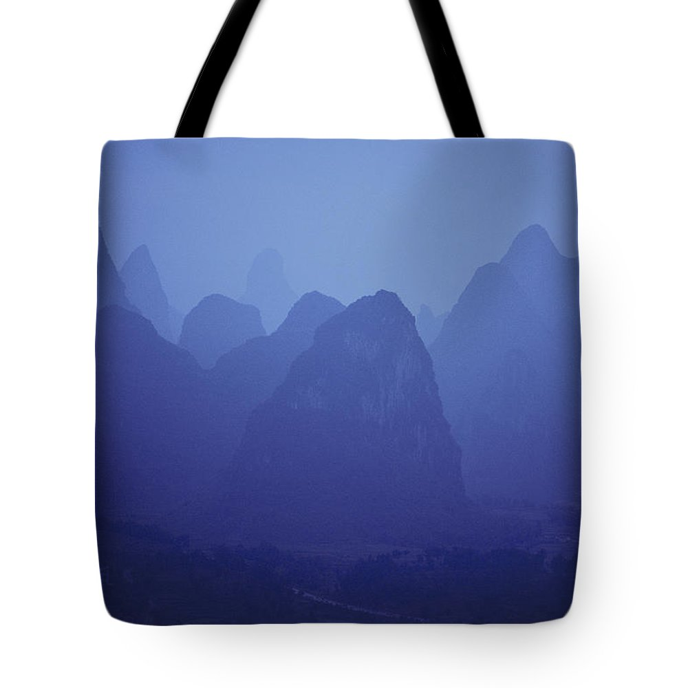 people's Republic Of China Tote Bag featuring the photograph Towers Of Stone, Guilin, China by Michael Nichols
