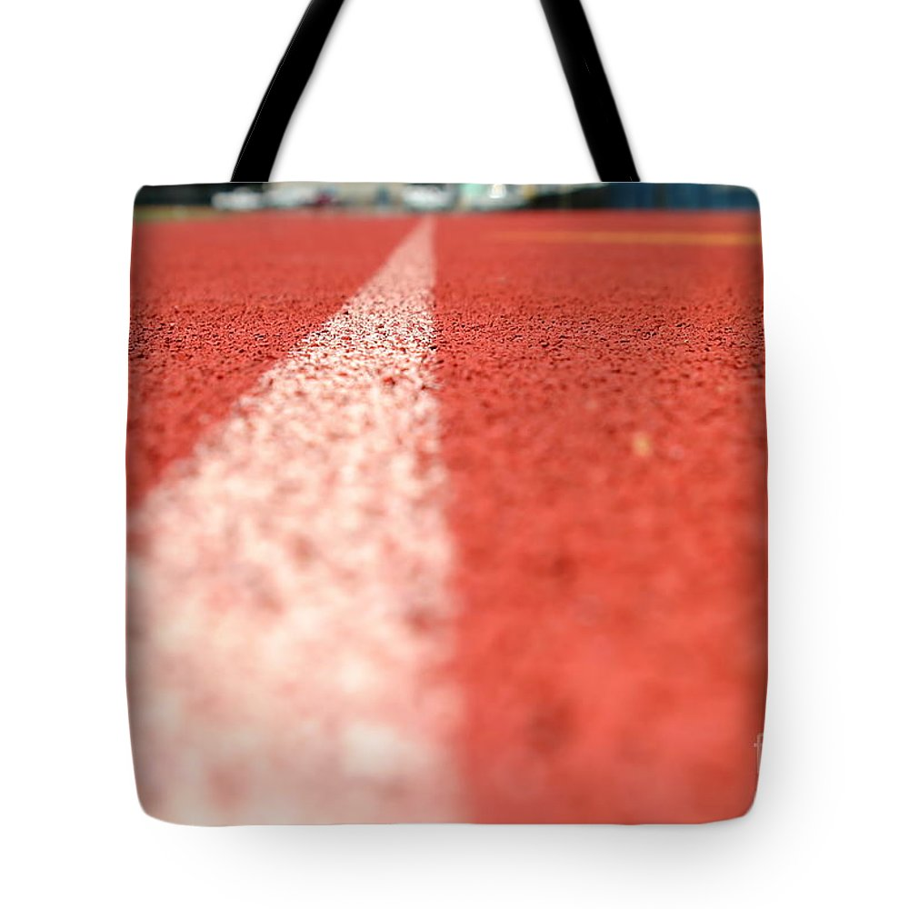 Athlete Tote Bag featuring the photograph Track Line by Henrik Lehnerer