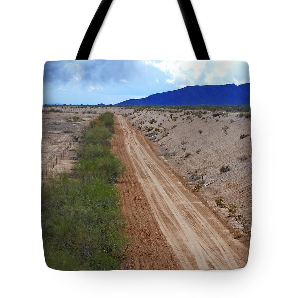Tracks To Nowhere Tote Bag featuring the photograph Tracks To Nowhere by Methune Hively