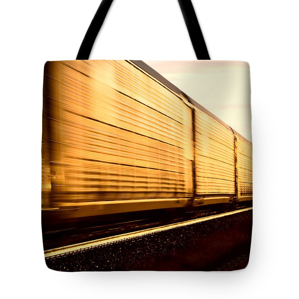 Sunset Tote Bag featuring the photograph Train At Sunset by Mark Duffy
