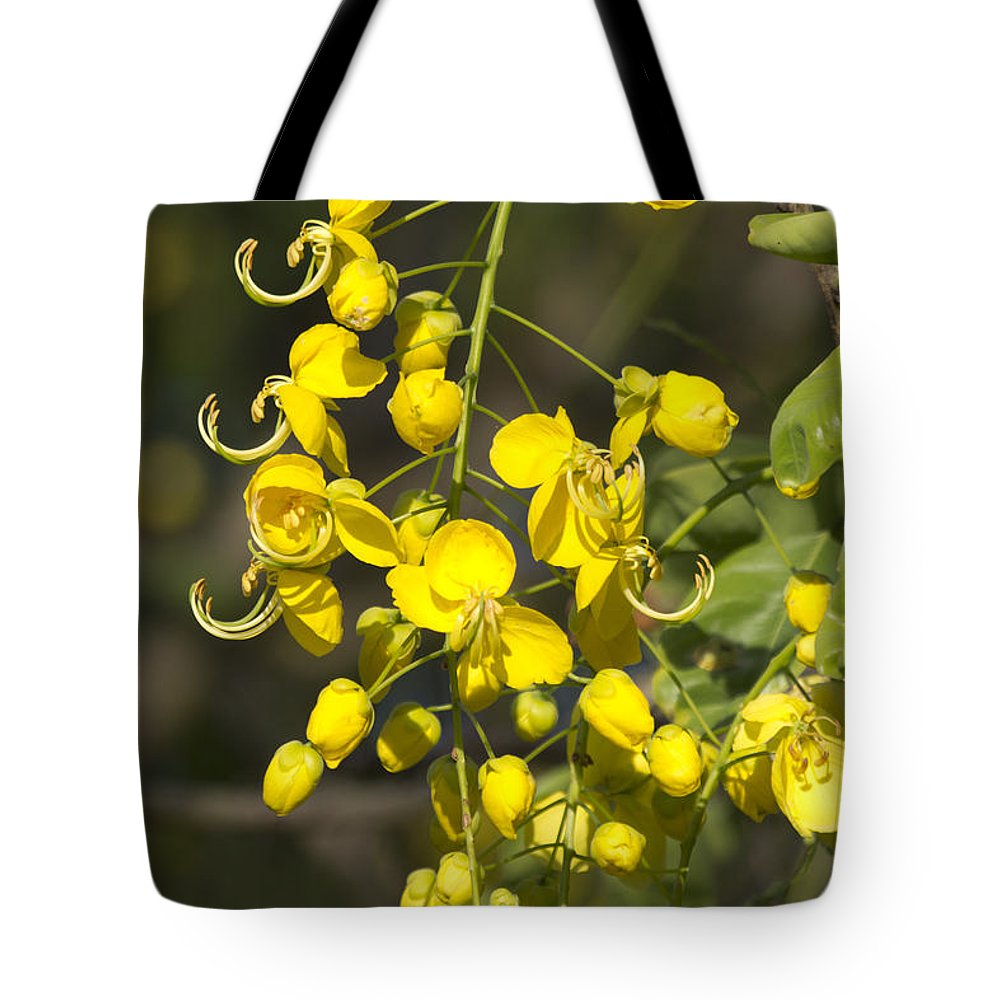 Tropical Yellow Tote Bag featuring the photograph Tropical Yellow Flowers by Douglas Barnard