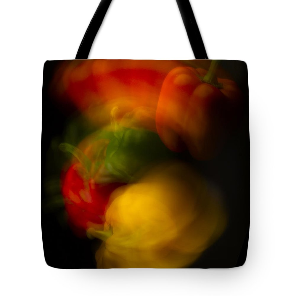 Colorful Tote Bag featuring the photograph Twisting Peppers by Frederic A Reinecke