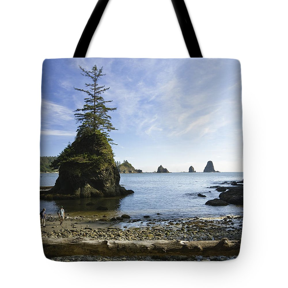 Mp Tote Bag featuring the photograph Two Hikers Walk On Beach With Sea by Konrad Wothe