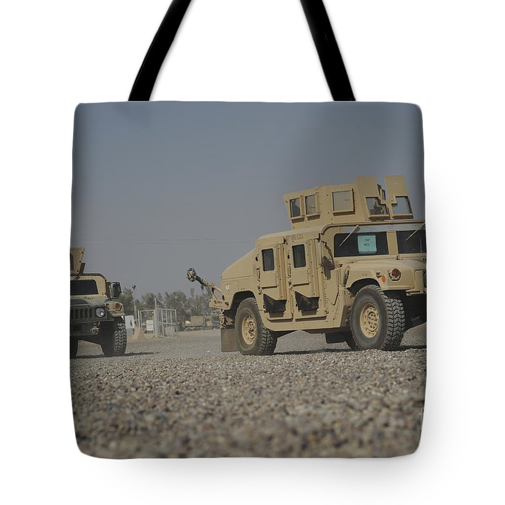 Horizontal Tote Bag featuring the photograph Two M1114 Humvee Vehicles At Camp Taji by Stocktrek Images