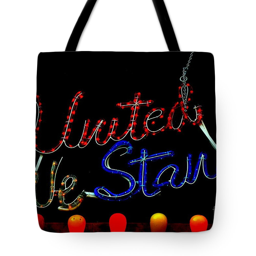 Red Tote Bag featuring the photograph United We Stand by Newel Hunter