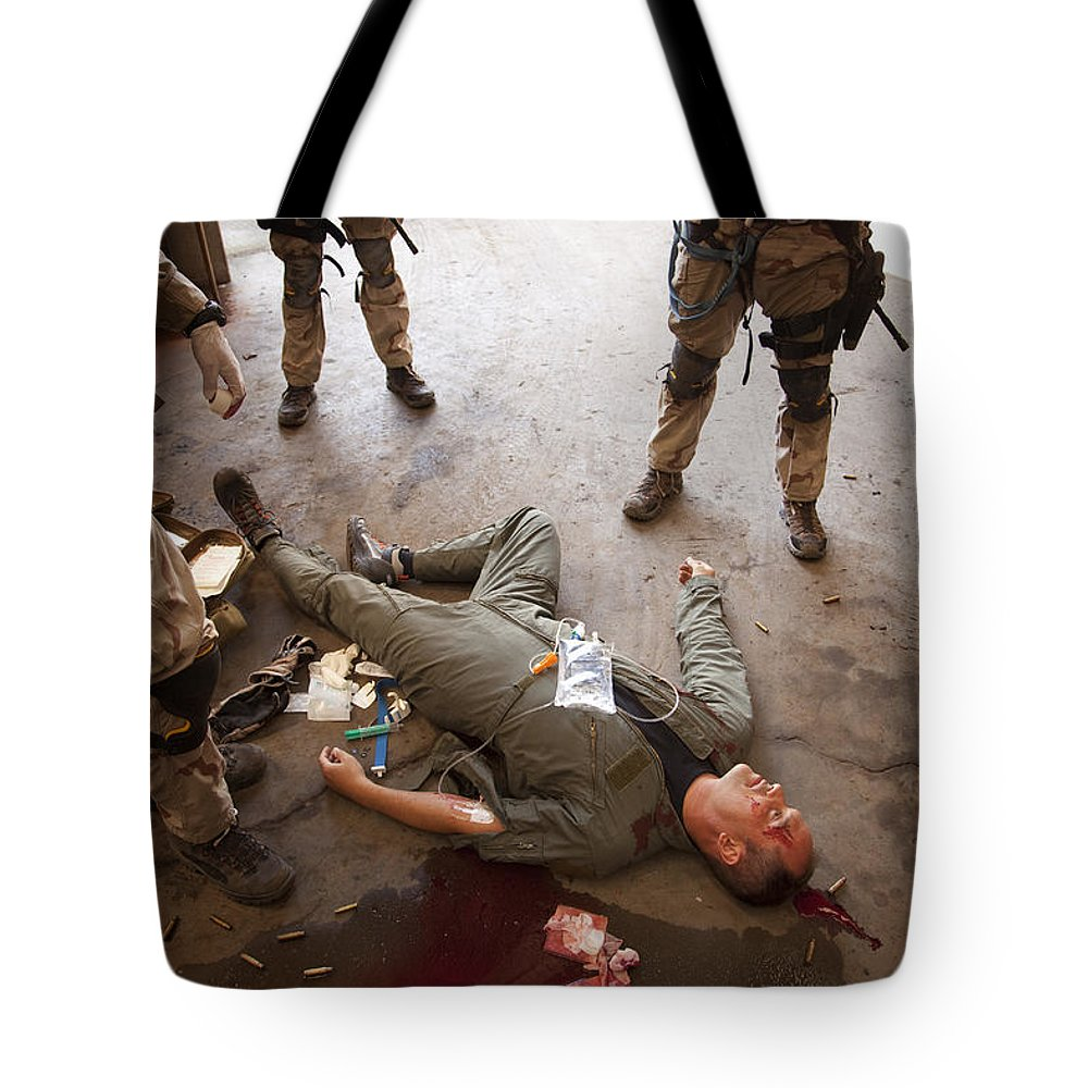 Special Operations Forces Tote Bag featuring the photograph U.s. Air Force Csar Parajumpers Giving by Tom