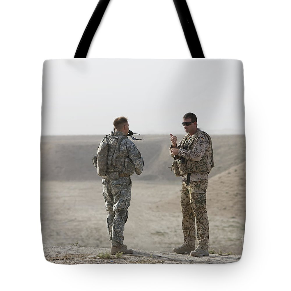 Us Army Tote Bag featuring the photograph U.s. Army Soldier And German Soldier by Terry Moore