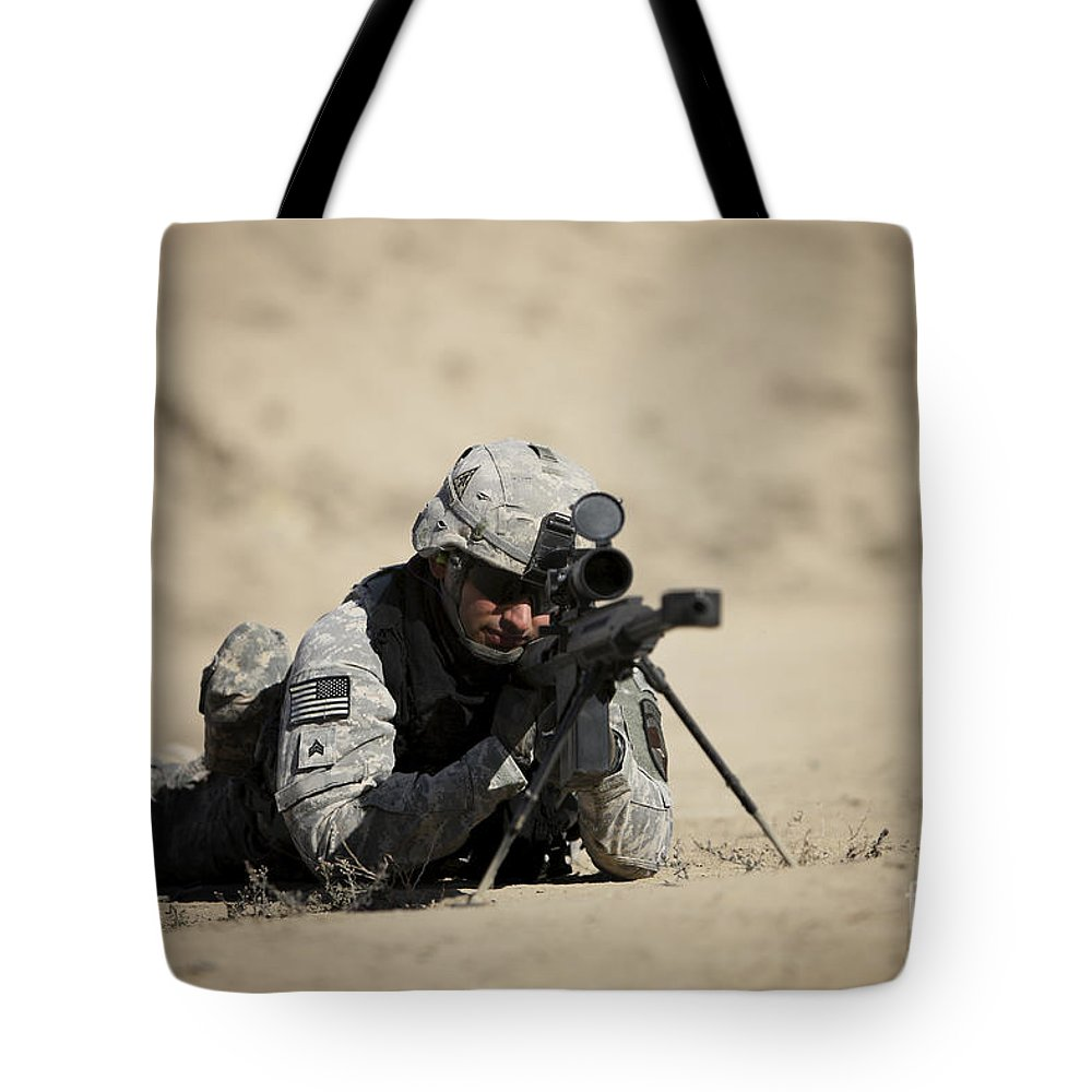 Operation Enduring Freedom Tote Bag featuring the photograph U.s. Army Soldier Sights In A Barrett by Terry Moore