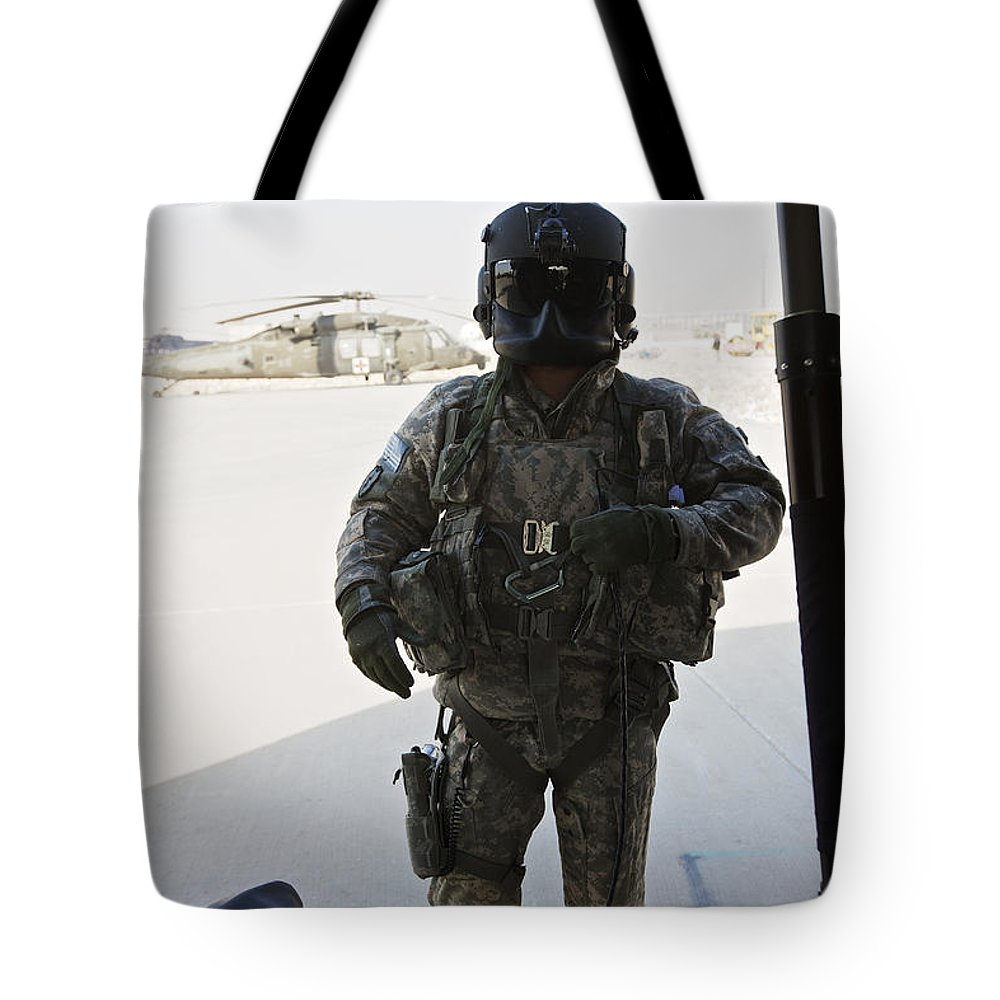 Helicopter Tote Bag featuring the photograph U.s. Army Uh-60l Loadmaster Confirms by Terry Moore