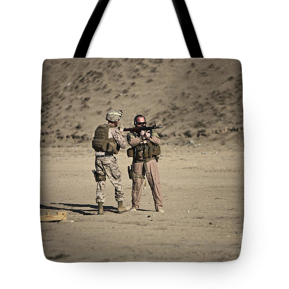 Afghanistan Tote Bag featuring the photograph U.s. Contractor Firing An Automatic by Terry Moore