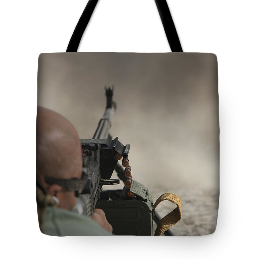 Kunduz Tote Bag featuring the photograph U.s. Contractor Firing The Pkm 7.62 by Terry Moore
