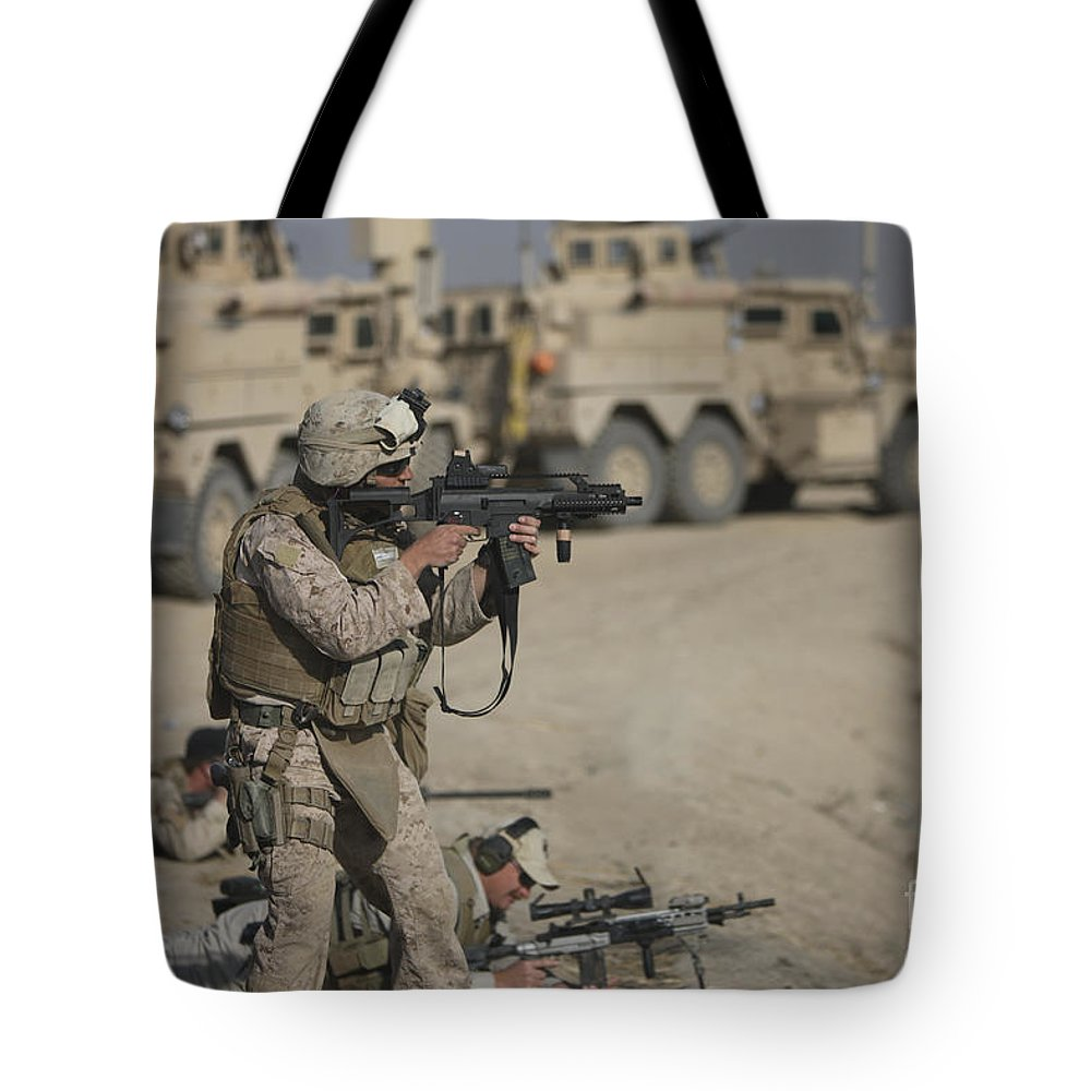 Operation Enduring Freedom Tote Bag featuring the photograph U.s. Marine Fires A G36k Carbine by Terry Moore