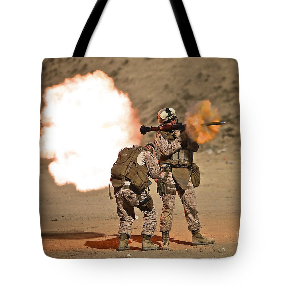 Operation Enduring Freedom Tote Bag featuring the photograph U.s. Marine Fires A Rpg-7 Grenade by Terry Moore
