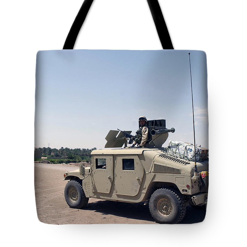 Horizontal Tote Bag featuring the photograph U.s. Marine Pulls Security On Top by Stocktrek Images