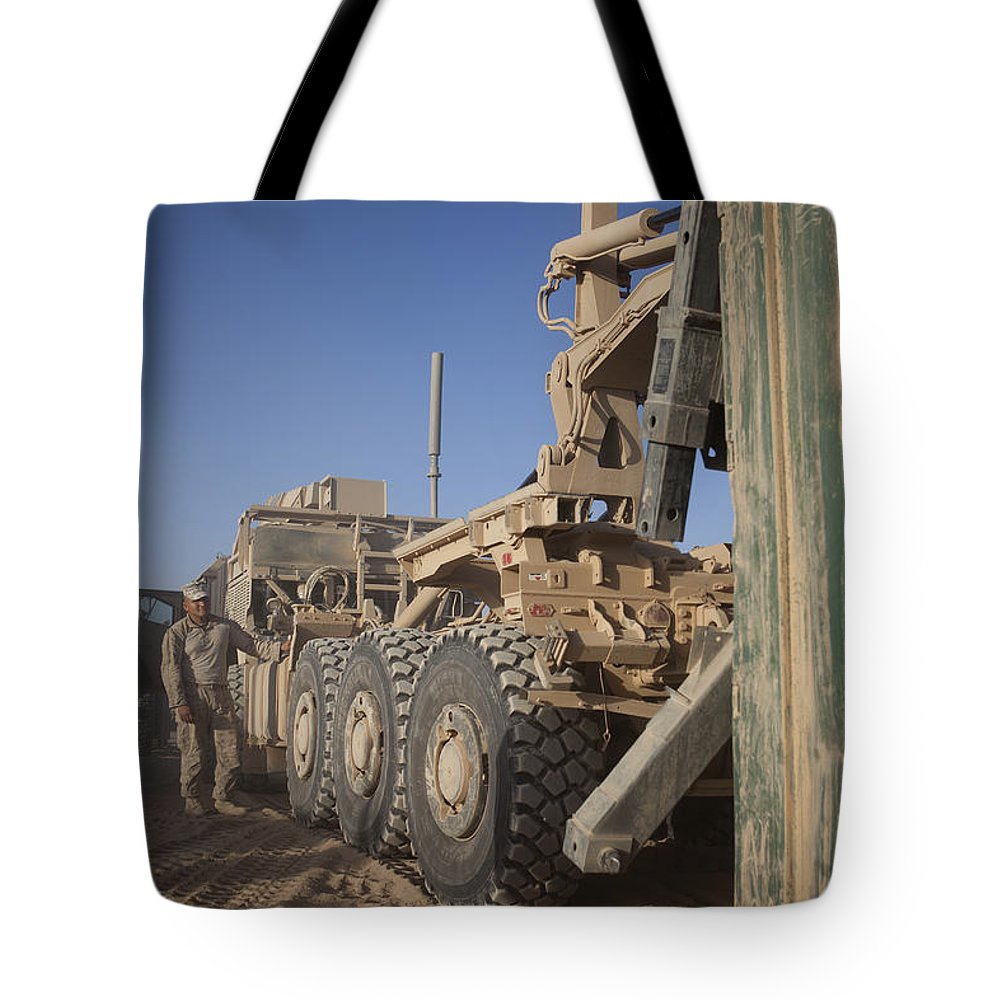 Operation Enduring Freedom Tote Bag featuring the photograph U.s. Marine Uses A Logistics Vehicle by Stocktrek Images